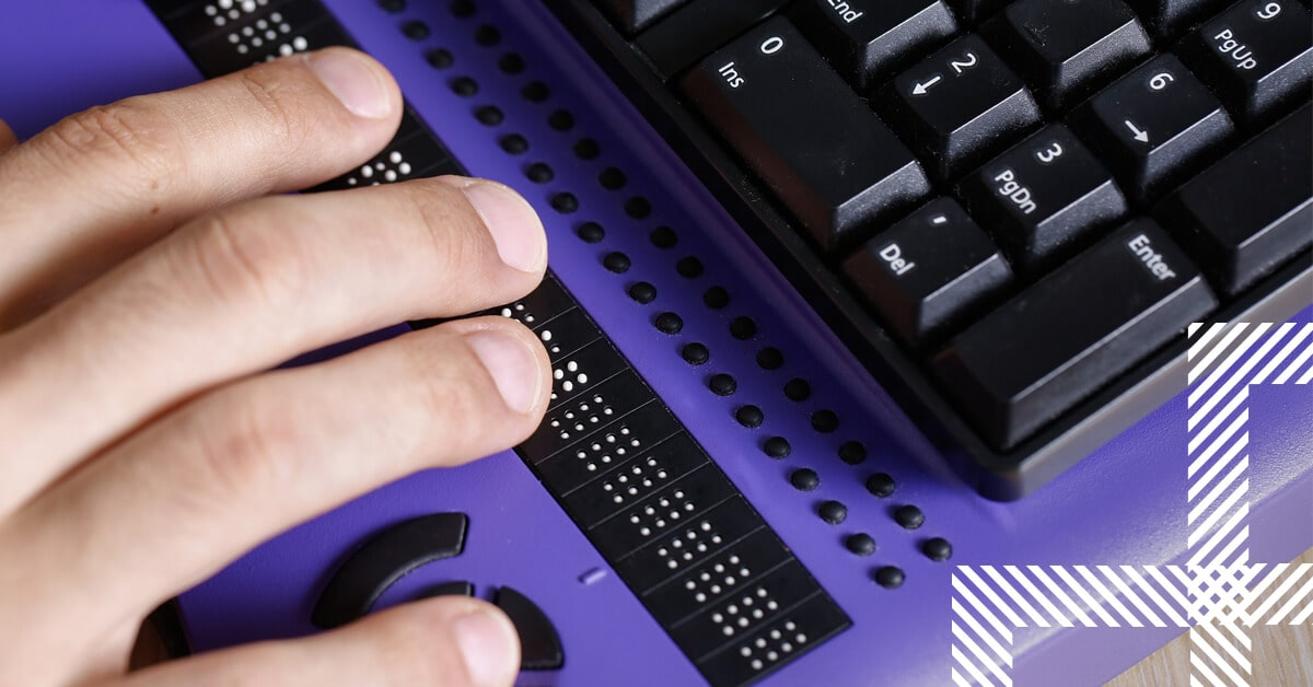 Person uses computer with braille computer display