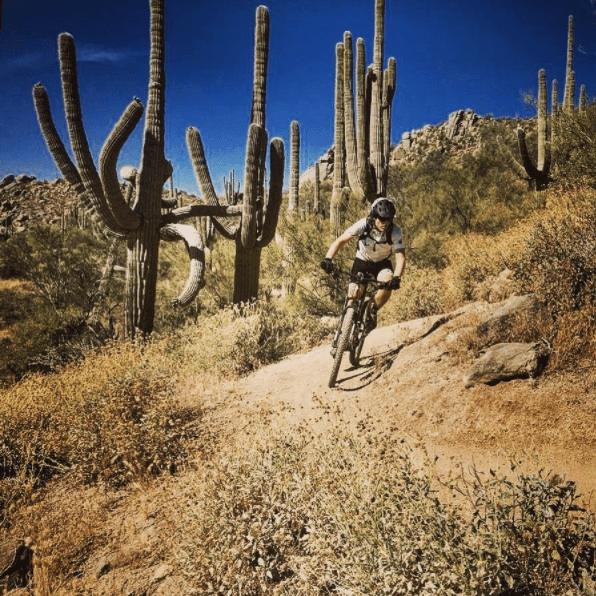 Pete rides his bike on an Arizona trail