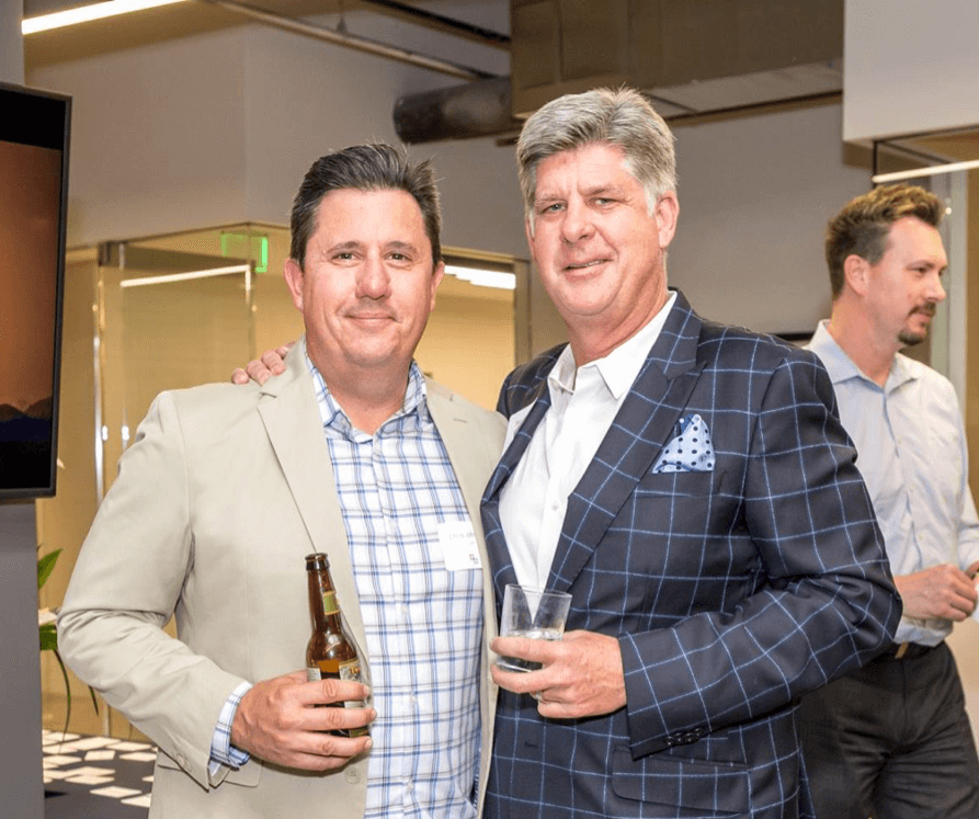 Chris Johnson and Beau Lane celebrate the new office location in Phoenix
